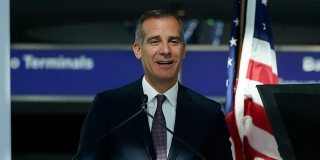 Los Angeles Mayor Eric Garcetti speaks a press conference at the new West Gates at Tom Bradley International Terminal at Los Angeles International Airport Monday, May 24, 2021, in Los Angeles. (AP Photo/Ashley Landis)