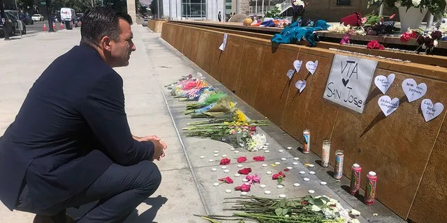 San Jose Mayor Sam Liccardo stops to view a makeshift memorial for the rail yard shooting victims in front of City Hall in San Jose, Calif., on Thursday, May 27, 2021. (Associated Press)