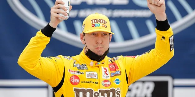 Kyle Busch celebrated in Victory Lane after winning a NASCAR Cup Series auto race at Kansas Speedway.