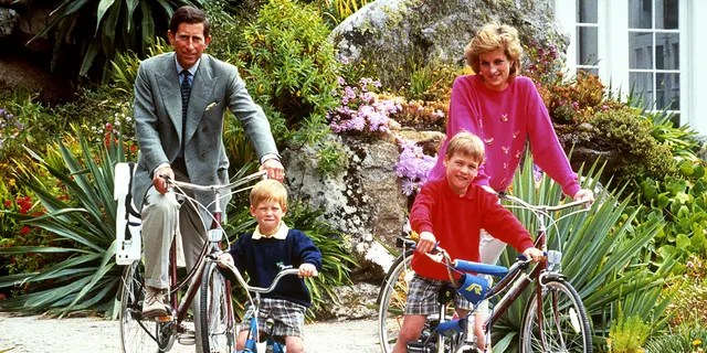 The Prince and Princess of Wales with sons Prince William, right, and Prince Harry prepare for a cycling trip in Tresco during their holiday in the Scilly Isles.  (Photo by PA Images via Getty Images)
