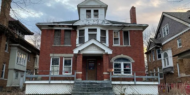 """In this March 8, 2021 file photo, a house, in need of repair, sits along East Grand Boulevard, in Detroit. Nicole Curtis, the star of HGTV's """"Rehab Addict Rescue,"""" has won a dispute with Detroit over ownership of a blighted home."""