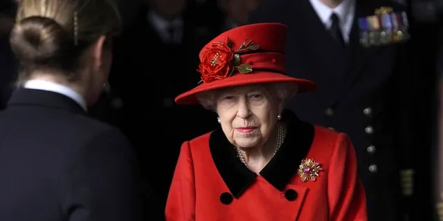 Britain's Queen Elizabeth II smiles during a visit to HMS Queen Elizabeth at HM Naval Base, ahead of the ship's maiden deployment, in Portsmouth, England, Saturday May 22, 2021. The monarch wore a brooch reportedly given to her by the late Prince Philip for the outing. (Steve Parsons/Pool Photo via AP)