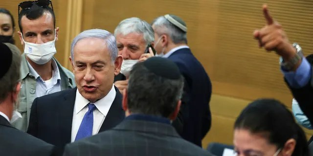 Israeli Prime Minister Benjamin Netanyahu looks on after a special session of the Knesset whereby Israeli lawmakers elected Isaac Herzog as the nation's new president, in Jerusalem Wednesday, June 2, 2021. (Associated Press)