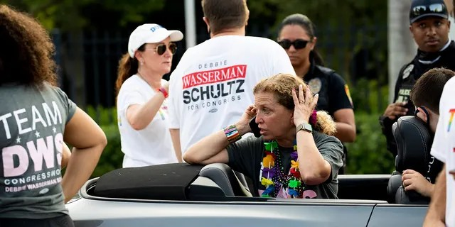 Rep. Debbie Wasserman Schultz, D-Fla., makes a call after a truck drove into a crowd of people during The Stonewall Pride Parade and Street Festival in Wilton Manors, Fla., Saturday, June 19, 2021. (Chris Day/South Florida Sun-Sentinel via AP)