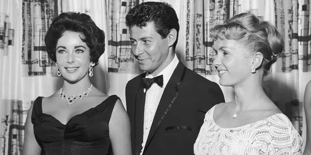Eddie Fisher with his future ex-wives Elizabeth Taylor (left) and Debbie Reynolds.