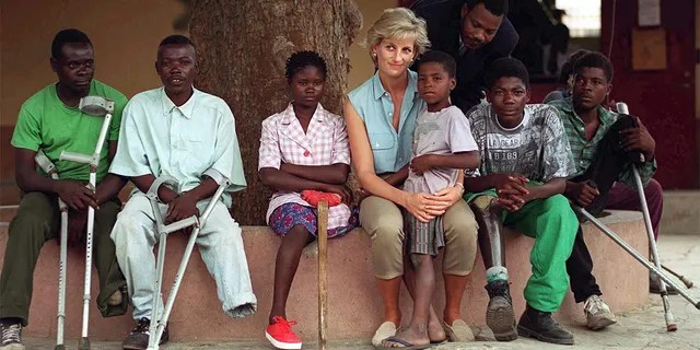 Diana, Princess of Wales, with children injured by mines at the Neves Bendinha Orthopaedic Workshop In Luanda, Angola.