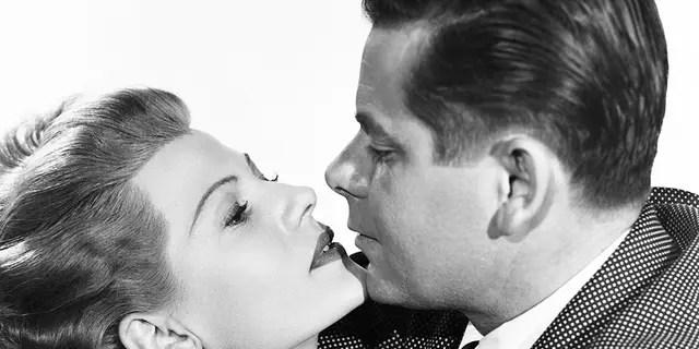 American actress Rita Hayworth (born Margarita Cansino, 1918 - 1987) (as Gilda Farrell) and Canadian-American actor Glenn Ford (1916 - 2006) (as Johnny Farrell/Narrator) in 'Gilda' (directed by Charles Vidor), Hollywood, California, 1946.