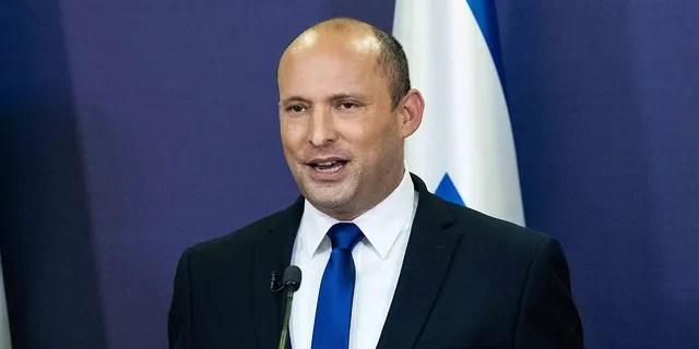Yemina party leader Naftali Bennett speaks to the Israeli Parliament in Jerusalem, Sunday, May 30, 2021.