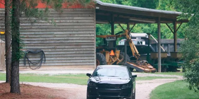 A vehicle sits in the driveway of a home, Tuesday, June 8, 2021, in rural Colleton County, near Islandton, S.C. A mother and son from a prominent South Carolina legal family were found shot and killed on the family's land, and authorities said they have made no arrests in the double homicide case. Maggie Murdaugh , 52, and her son Paul Murdaugh, 22, were shot several times and their bodies were found near a dog kennel, Colleton County Coroner Richard Harvey said. (Andrew J. Whitaker/The Post And Courier via AP)