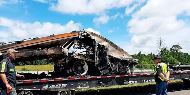 Some of the wreckage from a fatal multiple-vehicle crash is loaded to be carried away Sunday in Butler County, Ala. (Lawrence Specker/Press-Register/AL.com via AP)
