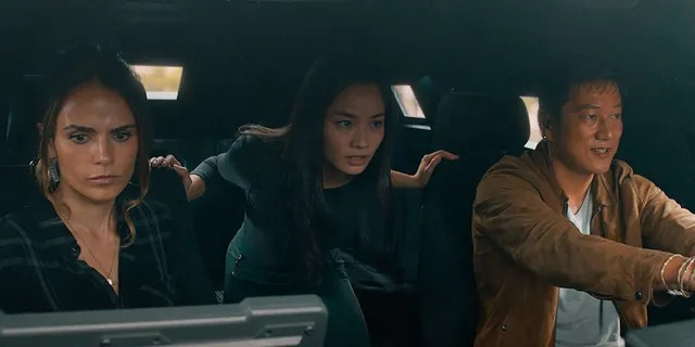 """This image released by Universal Pictures shows Jordana Brewster, from left, Anna Sawai and Sung Kang in a scene from """"F9: The Fast Saga."""""""