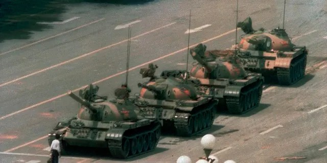 In this June 5, 1989, file photo, a man stands alone in front of a line of tanks heading east on Beijing's Changan Blvd. in Tiananmen Square, Beijing. Hong Kong's second ban on an annual vigil for victims of the bloody June 4, 1989, crackdown on Beijing's Tiananmen Square protest movement and the closure of a museum dedicated to the event may be a further sign that the ruling Communist Party is extending its efforts to erase the event from the collective consciousness from the mainland to Hong Kong. (AP Photo/Jeff Widener, File)