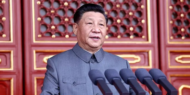 In this photo provided by China's Xinhua News Agency, Chinese President and party leader Xi Jinping delivers a speech at a ceremony marking the centenary of the ruling Communist Party in Beijing. (Ju Peng/Xinhua via AP)