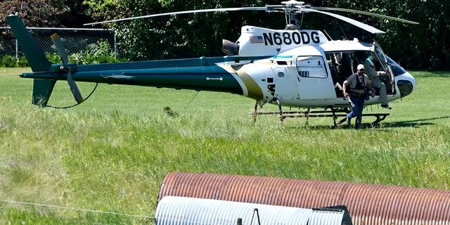 A Montana Department of Fish, Wildlife and Parks helicopter lands in Ovando, Mont., on Tuesday, July 6, 2021, after searching for a bear that killed a camper early that morning. (Tom Bauer/The Missoulian via AP)