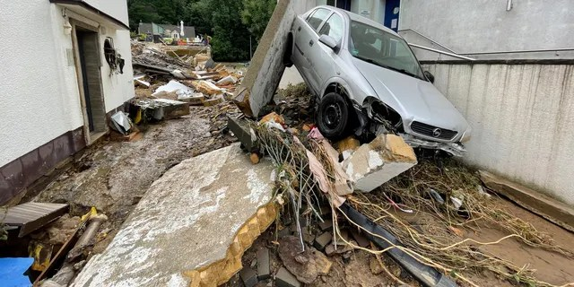 A street is covered with debris in Bad Muenstereifel, Germany, Thursday, July 15, 2021, after heavy rainfall and the flooding of the Erft river. People have died and dozens of people are missing in Germany after heavy flooding turned streams and streets into raging torrents, sweeping away cars and causing some buildings to collapse. (B&S/dpa via AP)