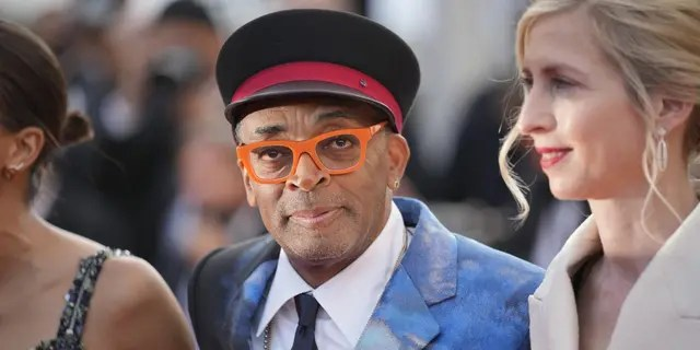 Jury president Spike Lee, centre, poses for photographers upon arrival at the awards ceremony and premiere of the closing film 'OSS 117: From Africa with Love' at the 74th international film festival, Cannes, southern France, Saturday, July 17, 2021. (AP Photo/Vadim Ghirda)