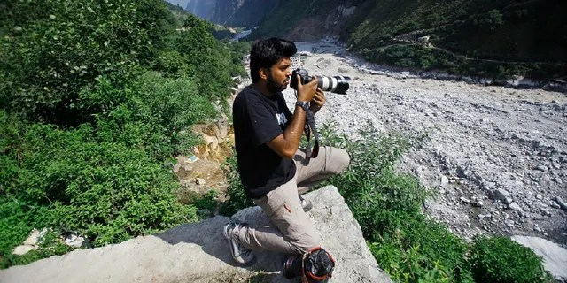 Reuters photographer Danish Siddiqui covers the monsoon floods and landslides in the upper reaches of Govindghat, India, Saturday, June 22, 2013. (AP)