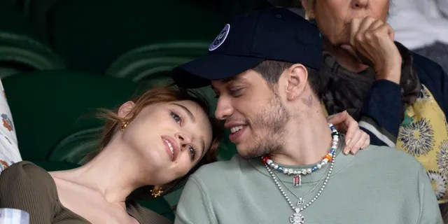 Phoebe Dynevor rests her head on Pete Davidson's shoulder at Wimbledon Tennis Championships at the All England Lawn Tennis and Croquet Club on July 03, 2021 in London. (Photo by Karwai Tang/WireImage)