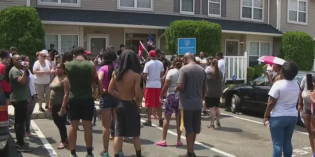 Protesters outside a home in Mt. Laurel, N.J.