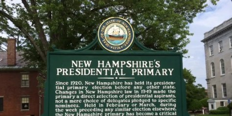 A sign outside the New Hampshire state capital building that marks the state's century long tradition of holding the first-in-the-nation presidential primary, in Concord, New Hampshire.