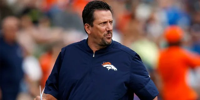 FILE - In this August 4, 2016 file photo, Greg Knapp, Denver Broncos quarterbacks coach, looks at NFL football training camp in Englewood, Colorado.  Knapp, currently an assistant coach for New York Jets, was in a