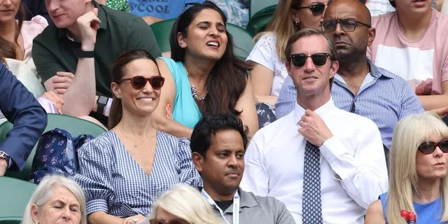 Pippa Middleton and her husband James Matthews look on from the stand on day 11 of The Championships at Wimbledon.
