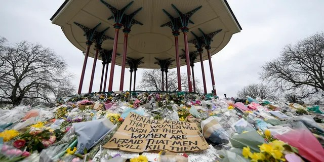Floral tributes and messages are placed at the bandstand on Clapham Common in London in memory of Sarah Everard in March. (AP)