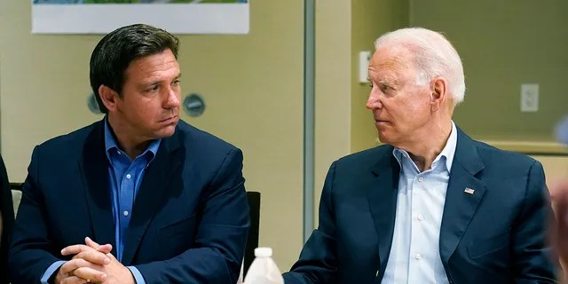 President Joe Biden, right, looks at Florida Gov. Ron DeSantis, left, during a briefing with first responders and local officials in Miami, Thursday, July 1, 2021, on the condo tower that collapsed in Surfside, Fla., last week. (AP Photo/Susan Walsh)
