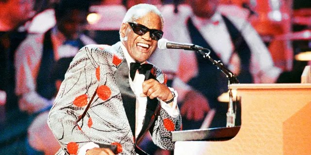 FILE - Ray Charles, performs during the taping of 'Ray Charles: 50 Years in Music, uh-huh,' a benefit musical gala for Starlight/Starbright Foundation in Pasadena, Calif. on Sept. 20, 1991. Charles will be inducted into the Country Music Hall of Fame. (AP Photo/Kevork Djansezian, File)