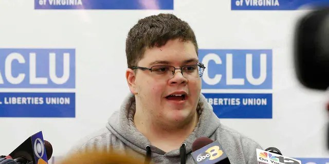 In this March 6, 2017, file photo, Gloucester County High School senior Gavin Grimm, a transgender student, speaks during a news conference in Richmond, Virginia. The Gloucester County School Board has agreed to pay $1.3 million in legal costs to the American Civil Liberties Union after the nonprofit spent six years representing a student who sued over the board's transgender bathroom ban.
