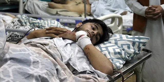 Afghans lie on beds at a hospital after they were wounded in the deadly attacks outside the airport in Kabul, Afghanistan, Thursday, Aug. 26, 2021. (Associated Press)