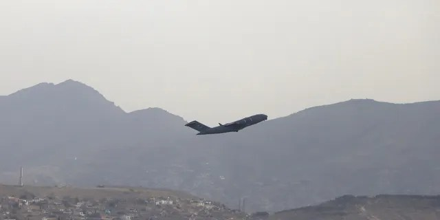 A U.S military aircraft takes off from the Hamid Karzai International Airport in Kabul, Afghanistan, on Monday.
