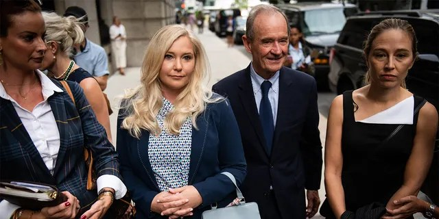 David Boies, representing several of Jeffrey Epstein's alleged victims, center, arrives with Annie Farmer, right, and VirginiaGiuffre, alleged victims of Jeffrey Epstein, second left, at federal court in New York, U.S., on Tuesday, Aug. 27, 2019. Epstein, a convicted pedophile, killed himself in prison while awaiting trial on charges of conspiracy and trafficking minors for sex.