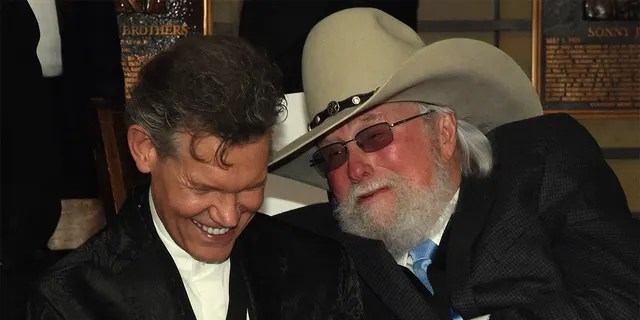 HOF members Randy Travis and Charlie Daniels attend the Country Music Hall Of Fame And Museum Hosts Medallion Ceremony To Celebrate 2017 Hall Of Fame Inductees Alan Jackson, Jerry Reed And Don Schlitz at Country Music Hall of Fame and Museum on October 22, 2017 in Nashville, Tennessee.