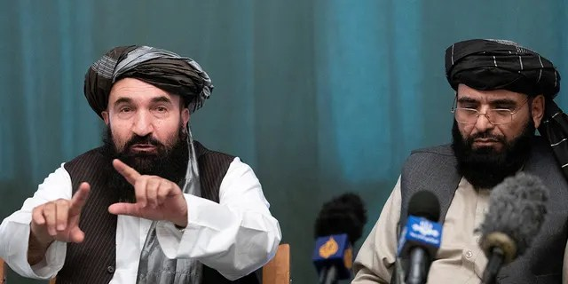 Members of the Taliban delegation: former western Herat Gov, Khairullah Khairkhwa and member of the negotiation team Suhail Shaheen attend a joint news conference in Moscow, Russia, March 19, 2021. Alexander Zemlianichenko/Pool via REUTERS