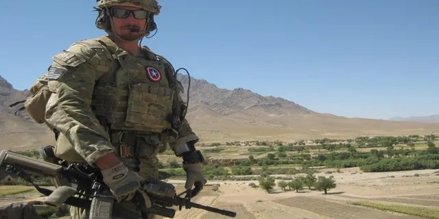 Army Capt. Zac Lois, a Green Beret commander, is shown here in Kandahar province in Afghanistan in 2012. He is now working remotely to help facilitate the evacuation of people out of Afghanistan. (Courtesy Zac Lois)