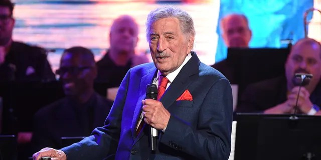 Tony Bennett performs at the opening ceremony of the Statue of Liberty Museum on May 15, 2019 in New York.  Bennett has canceled the dates of his Fall and Winter 2021 tour.  The legendary crooner is pulling out of concerts in New York, Maryland, Connecticut, Arizona, Oklahoma and Canada.