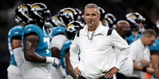 FILE - In this Monday, Aug. 23, 2021, file photo, Jacksonville Jaguars head coach Urban Meyer watches as his team warms up before a preseason NFL = football game against the New Orleans Saints in New Orleans.