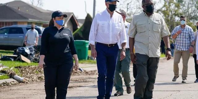 President Joe Biden tours a neighborhood impacted by Hurricane Ida, Friday, Sept. 3, 2021, in LaPlace, La. (AP Photo/Evan Vucci)