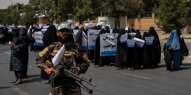 Women march in support of the Taliban government outside Kabul University, Afghanistan, on Saturday, Sept. 11, 2021.