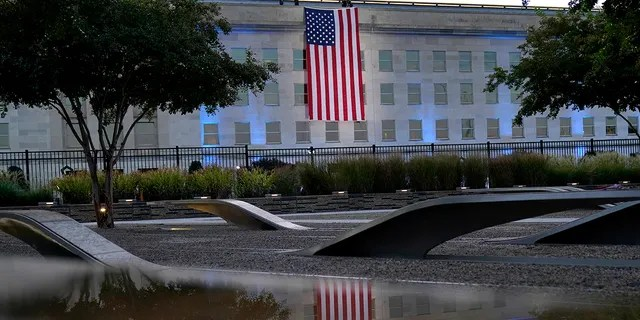 An American flag is unfurled at the Pentagon in Washington, Saturday, Sept. 11, 2021, at sunrise on the morning of the 20th anniversary of the terrorist attacks. (Associated Press)