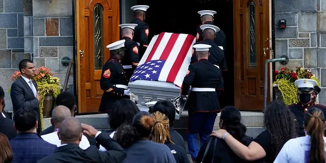 The casket of Sgt. Johanny Rosario Pichardo, a U.S. Marine who was among 13 service members killed in a suicide bombing in Afghanistan, is carried into the Farrah Funeral Home in her hometown of Lawrence, Mass, Saturday, Sept. 11, 2021.