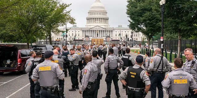 Police stage at a security fence ahead of a rally near the U.S. Capitol in Washington, Saturday, Sept. 18, 2021.