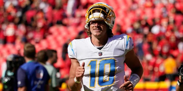 Los Angeles Chargers quarterback Justin Herbert (10) runs off the field following an NFL football game against the Kansas City Chiefs, Sunday, Sept. 26, 2021, in Kansas City, Mo. Los Angeles won 30-24. (AP Photo/Ed Zurga)