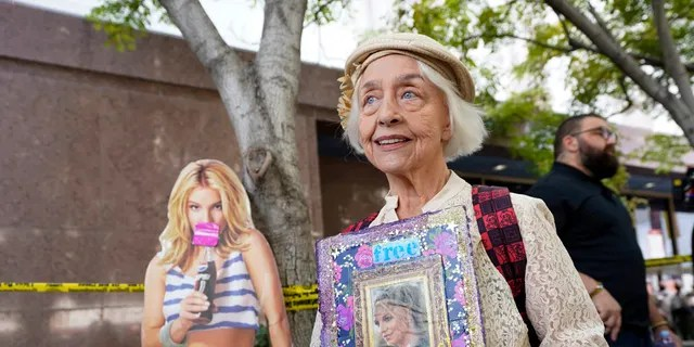 Britney Spears supporter Mona Montgomery of Glendale, Calif., performs outside the Stanley Mosque Courthouse on Wednesday, September 29, 2021 in Los Angeles.