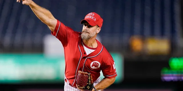 Rep. Greg Steube, R-Fla., pitches during the first inning of the Congressional baseball game at Nationals Park Wednesday, Sept. 29, 2021, in Washington. (AP Photo/Alex Brandon)