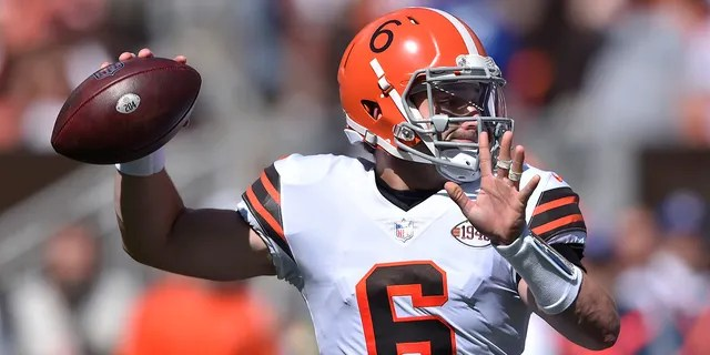 Cleveland Browns quarterback Baker Mayfield throws during the first half of an NFL football game against the Chicago Bears, Sunday, Sept. 26, 2021, in Cleveland.