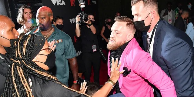 Conor McGregor being held back in an apparent scrum at the 2021 MTV Video Music Awards at Barclays Center on September 12, 2021 in the Brooklyn borough of New York City.