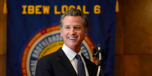 Gov. Gavin Newsom speaks to volunteers in San Francisco, Tuesday, Sept. 14, 2021. The recall election that could remove California Democratic Gov. Newsom is coming to an end. (AP Photo/Jeff Chiu)