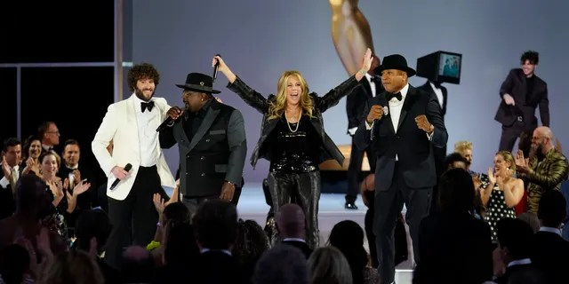 (L-R) Lil Dicky, Cedric The Entertainer, Rita Wilson, and LL Cool J appear onstage at the 73rd Emmy Awards.
